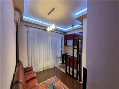 oferata vanzare apartament 3 camere, titan, bloc nou 2010, decomandat, etaj 7/11, 70mp utili, 2 bai,mobilat si utilat calitate premium, loc de parcare subteran si boxa de 12mp., disponibil pentru mutare imediat. Bucuresti
